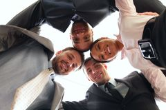 Mixed businessteam with heads together Royalty Free Stock Photography