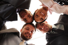 Mixed businessteam with heads together Stock Photos