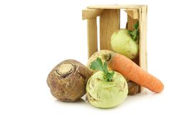 Mixed cabbage and root vegetables in a wooden crate Royalty Free Stock Photos