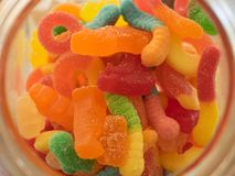 Mixed candies. Pot of mixed candy of different colors royalty free stock photo
