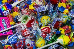 Mixed candy. Mixed paper wrapped candy, lollipops and bubble gums Stock Images