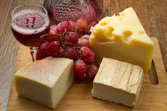 Mixed cheese with grapes Stock Image