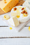 Mixed cheese with honey Royalty Free Stock Photos