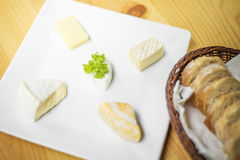 Mixed cheese platter with bread Royalty Free Stock Photography