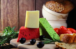 Mixed cheeses with olives Royalty Free Stock Photography
