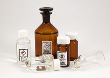 Mixed chemical bottles. The image shows some chemical flasks with the new GHS-Icons on it Stock Image