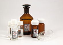 Mixed chemical bottles. The image shows some chemical flasks with the new GHS-Icons on it royalty free stock photos