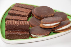 The mixed chocolate biscuits arranged on a plate Royalty Free Stock Images