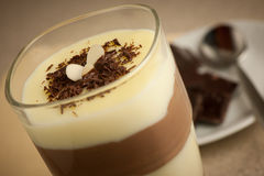 Mixed chocolate and vanilla pudding served in a glass decorated royalty free stock photos