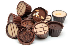 Mixed Chocolates heap on white Stock Images