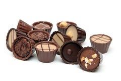 Mixed Chocolates heap on white Royalty Free Stock Photo