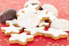 Mixed christmas biscuits on red background Stock Images