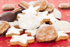 Mixed christmas cookies on red background Stock Photos