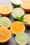 Mixed citrus fruit lemons, orange, kiwi, limes on a gray backgro Royalty Free Stock Photography