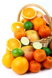 Mixed citrus fruit in wicker basket Stock Photo