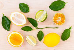 Mixed citruses fruit oranges, lemon and lime on wooden backgroun Royalty Free Stock Image