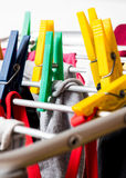 Mixed  clean laundry pinned with colourful clothespins Royalty Free Stock Photo