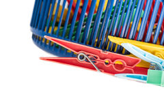 Mixed clothespins with plastic basket Royalty Free Stock Images