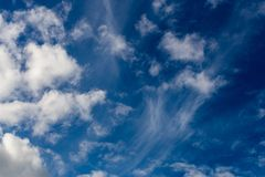 Mixed clouds closeup telephoto shot with polarizing effect. Mixed clouds closeup telephoto shot with polarizing effect royalty free stock image
