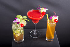 Mixed cocktails. Three cocktails displayed on black background stock photography