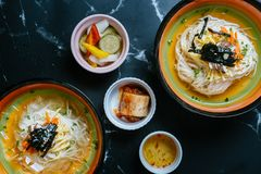 Mixed cold noodles with salad and seaweed in a bowl royalty free stock images