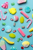 Mixed collection of colorful candy, on blue background Stock Image