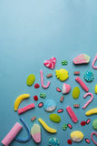 Mixed collection of colorful candy, on blue background Stock Images