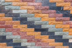 Mixed color brick wall, brown, blue grey, purple pattern backgro Stock Photography