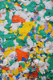 Mixed color pressed polystyrene panel. Multicolor pressed polystyrene recycled panel of different pieces utilized for construction and packaging Stock Photography