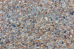 Mixed color stone background in red brown blue black grey. Color Stock Photo