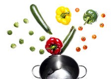 Mixed colorated peppers on white background Royalty Free Stock Photo