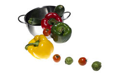 Mixed colorated peppers on white background Stock Photo