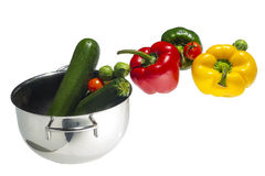 Mixed colorated peppers on white background Royalty Free Stock Images
