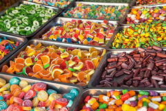 Mixed Colorful  Bonbons and Jellybeans. Colorful Assortment of Candy Bonbons and Jellybeans in the Metal Boxes . The colors are  Red, White, Yellow, orange Stock Photos