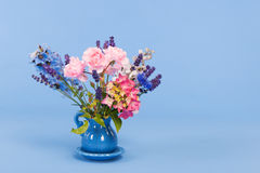 Mixed colorful bouquet on blue background Royalty Free Stock Images