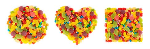Mixed colorful candies. Collection of heart, circle and square of color sweets on white royalty free stock photos