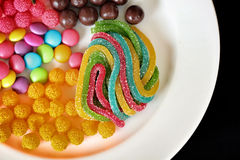 Mixed colorful candy. On black background Stock Photography