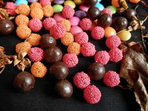 Mixed colorful candy. On black background Stock Images