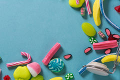 Mixed colorful candy on blue background, kids holidays Royalty Free Stock Image