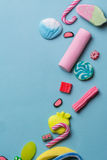 Mixed colorful candy on blue background, kids holidays Royalty Free Stock Images