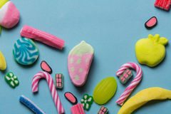 Mixed colorful candy on blue background, kids holidays Stock Image