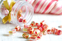 Mixed colorful candy lollipops. On white planks Stock Photos