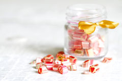 Mixed colorful candy lollipops. On white planks Royalty Free Stock Photos