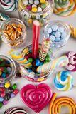 Mixed colorful sweets, lollipops and candy. Colorful lollipops and different colored round candy and gum balls Royalty Free Stock Photo
