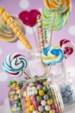 Mixed colorful sweets, lollipops and candy. Colorful lollipops and different colored round candy and gum balls Stock Images