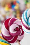 Mixed colorful sweets, lollipops and candy. Colorful lollipops and different colored round candy and gum balls Stock Photos