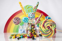 Mixed colorful sweets, lollipops and candy. Colorful lollipops and different colored round candy and gum balls Royalty Free Stock Image
