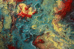 Mixed colors. Intensive water colors mixed together on the surface of wood Stock Images