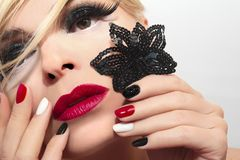 Mixed colors shiny black,red,white fashionable manicure. royalty free stock image