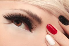 Mixed colors shiny black,red,white fashionable manicure. stock photos